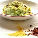 risotto verde con polvere di olive e mandarino