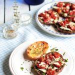 Melanzane ai pomodorini confit e scaglie di formaggio